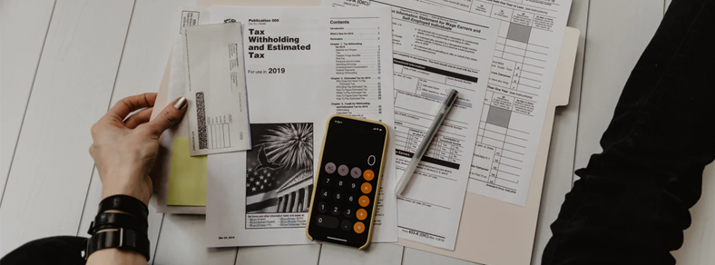 Paperwork and calculator on table